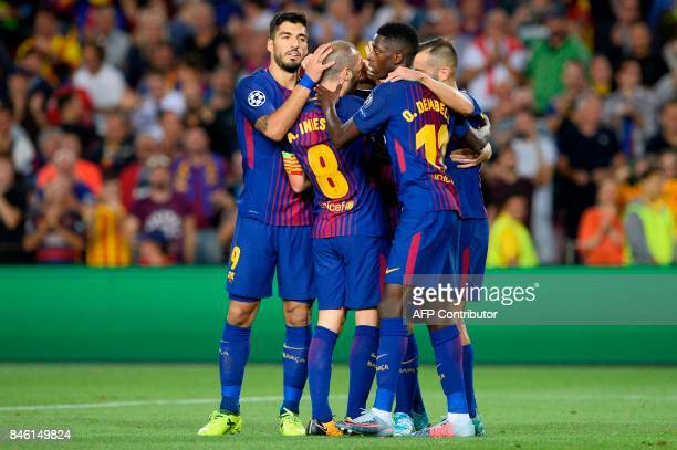 Barcelona's players celebrate their third goal during the UEFA Champions League Group D football match FC Barcelona vs Juventus at the Camp Nou...