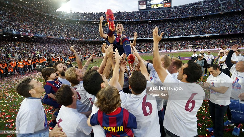 FC Barcelona's players celebrate winning the La Liga title with their team-mate <a gi-track='captionPersonalityLinkClicked' href=/galleries/search?phrase=Xavi+Hernandez+-+Soccer+Player&family=editorial&specificpeople=2834438 ng-click='$event.stopPropagation()'>Xavi Hernandez</a> in his farewell during the La Liga match between FC Barcelona and RC Deportivo La Coruña at Camp Nou on May 23, 2015 in Barcelona, Spain.