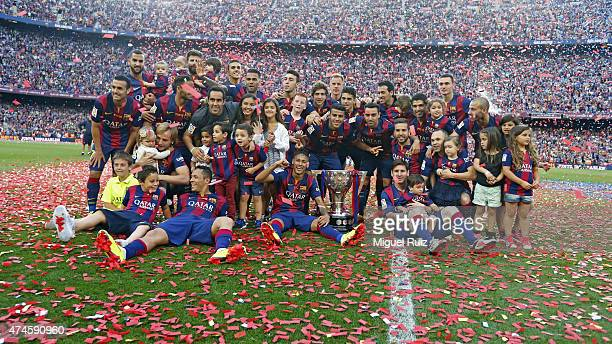 Barcelona's players celebrate with their families after winning the La Liga title during the La Liga match between FC Barcelona and RC Deportivo La...