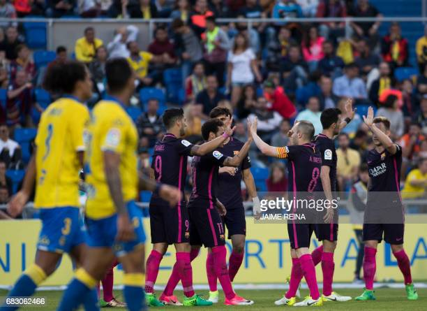 Barcelona's players celebrates after scoring during the Spanish league football match UD Las Palmas vs FC Barcelona at the Gran Canaria stadium in...