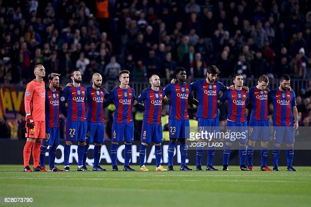 Barcelona's players observe a minute of silence for the victims of an airplane crash one week ago including members of the Brazilian football club...