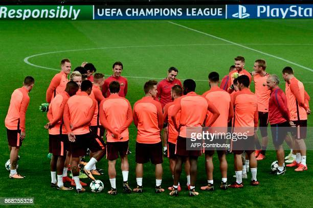 Barcelona's players take part in a Barcelona training at the Giorgos Karaiskakis stadium in Piraeus near Athens on October 30 on the eve of the UEFA...