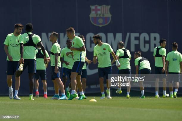 Barcelona's players take part in a training session at the Sports Center FC Barcelona Joan Gamper in Sant Joan Despi near Barcelona on May 26 2017 on...