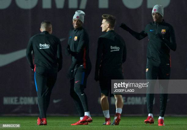 Barcelona's Portuguese defender Nelson Semedo and Barcelona's French forward Ousmane Dembele take part in a training session at the FC Barcelona Joan...