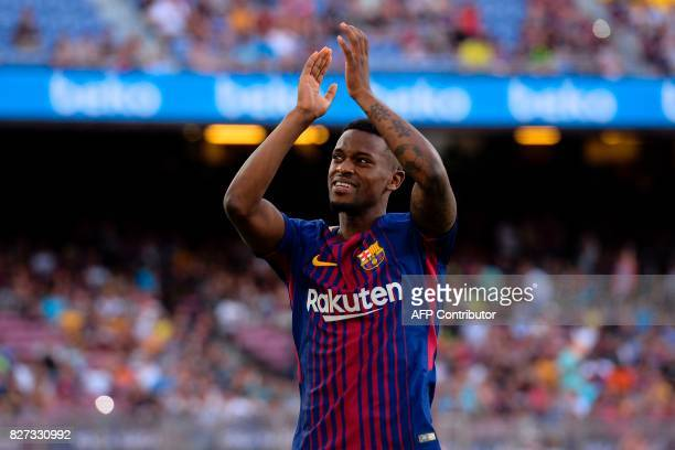 Barcelona's Portuguese defender Nelson Semedo applauds to supporters before the 52nd Joan Gamper Trophy friendly football match between Barcelona FC...