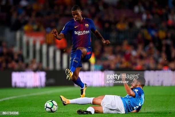 Barcelona's Portuguese defender Nelson Semedo challenges Malaga's defender Juan Carlos Perez during the Spanish league football match FC Barcelona vs...
