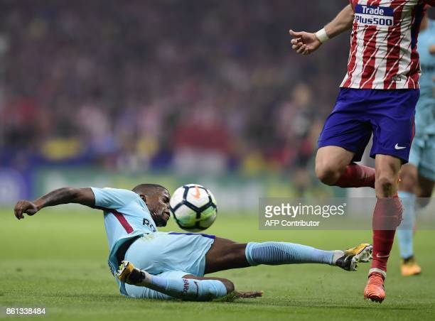 Barcelona's Portuguese defender Nelson Semedo falls down during the Spanish league football match Club Atletico de Madrid vs FC Barcelona at the...