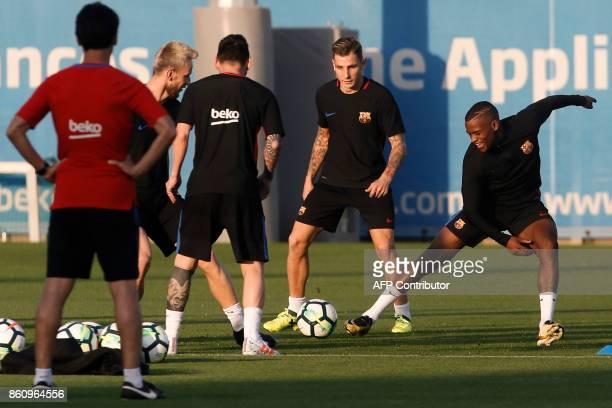 Barcelona's Portuguese defender Nelson Semedo smiles during a training session at the Joan Gamper Sports Center in Sant Joan Despi near Barcelona on...