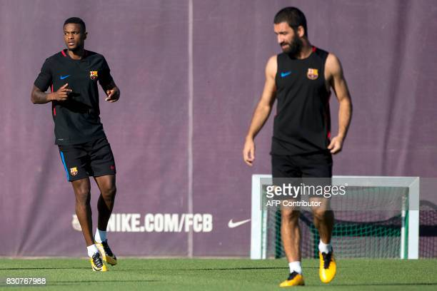 Barcelona's Portuguese defender Nelson Semedo takes part in a training session at the sports Center FC Barcelona Joan Gamper in Sant Joan Despi near...