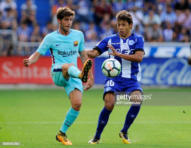 Barcelona's Portuguese midfielder Andre Gomes vies with Deportivo Alaves' Paraguayan midfielder Oscar Romero during the Spanish league football match...
