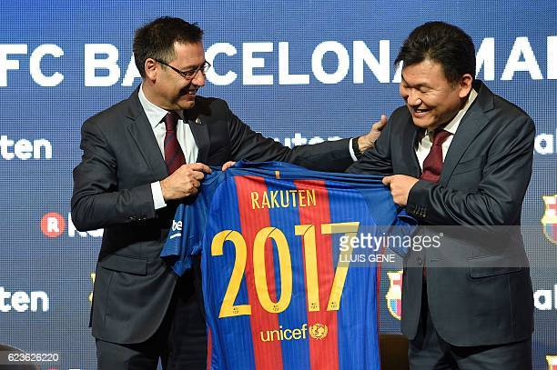 Barcelona's president Josep Maria Bartomeu and CEO of Japanese company Rakuten Hiroshi Mikitani display the FC Barcelona's new jersey after signing...