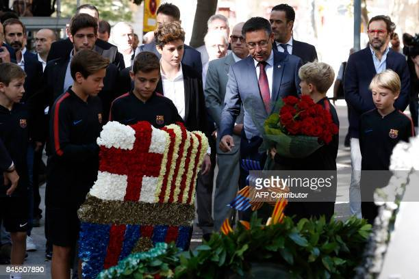Barcelona's president Josep Maria Bartomeu and other members of the FC Barcelona team attend a wreathlaying ceremony at the Rafael de Casanovas...