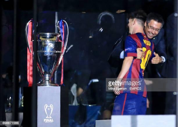 Barcelona's president Josep Maria Bartomeu celebrates with Lionel Messi before the trophy presentation