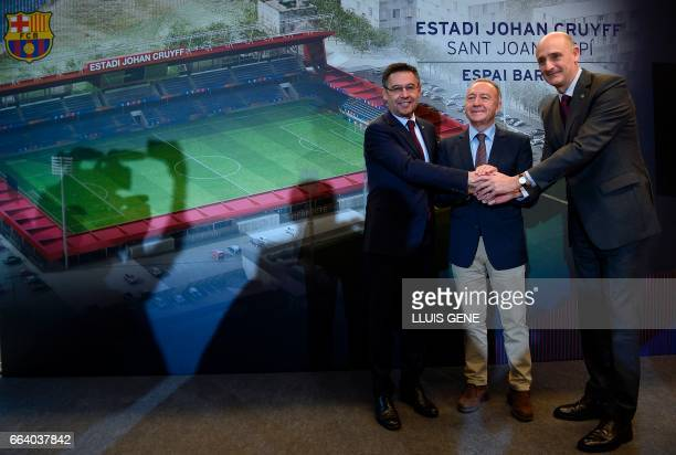 Barcelona's president Josep Maria Bartomeu Jordi Moix of 'Espai Barça' and major of Sant Joan Despi Antoni Poveda pose during the presentation of a...