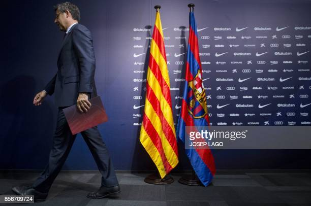 FC Barcelona's president Josep Maria Bartomeu leaves after giving a press conference at the Camp Nou stadium in Barcelona on October 2 2017 Barcelona...