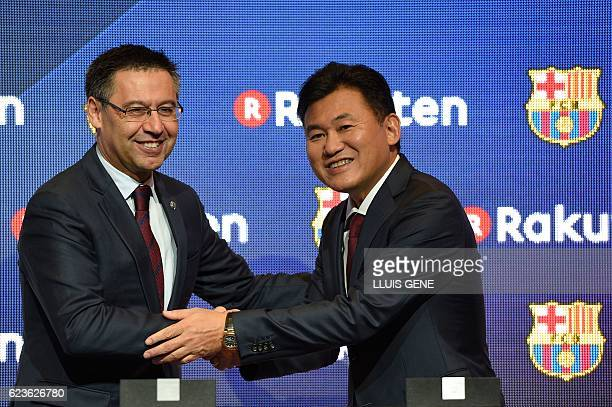 Barcelona's president Josep Maria Bartomeu shakes hands with CEO of Japanese company Rakuten Hiroshi Mikitani after signing an agreement between FC...
