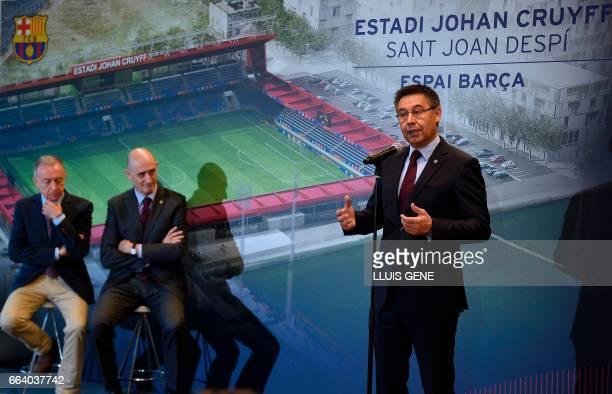 Barcelona's president Josep Maria Bartomeu speaks as Jordi Moix of 'Espai Barça' and major of Sant Joan Despi Antoni Poveda listen during the...