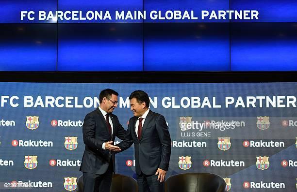 Barcelona's president Josep Maria Bartomeu talks with CEO of Japanese company Rakuten Hiroshi Mikitani after signing an agreement between FC...