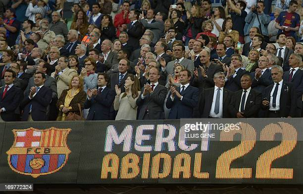 Barcelona's President Sandro Rosell applauds during a tribute in honor of Barcelona's French defender Eric Abidal after the Spanish league football...