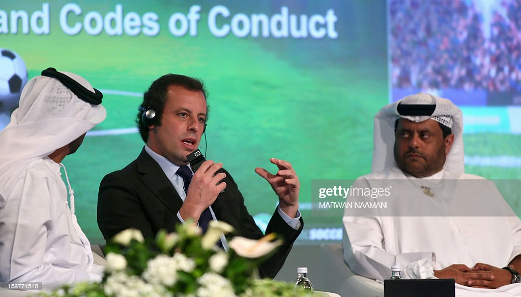 Barcelona's president Sandro Rosell (C) speaks during a panel discussion along with vice president of the UAE Football Association, Mohammed Thani al-Rumaithi (R) during the first session of the International Sports Conference in Dubai on December 28, 2012. AFP PHOTO/MARWAN NAAMANI