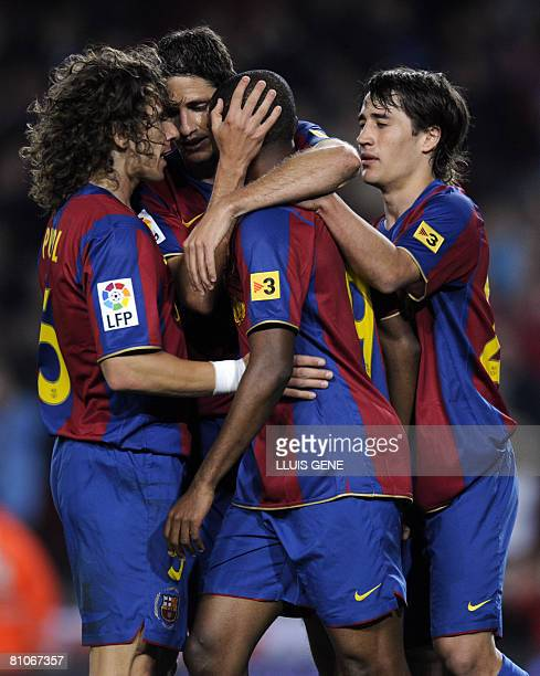 FC Barcelona's Puyol Edmilson Eto'o and Bojan celebrate the second goal Mallorca during their Spanish League football match on May 11 2008 at Camp...
