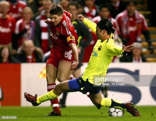 Barcelona's Rafael Marquez and Liverpool's Steven Gerrard in action