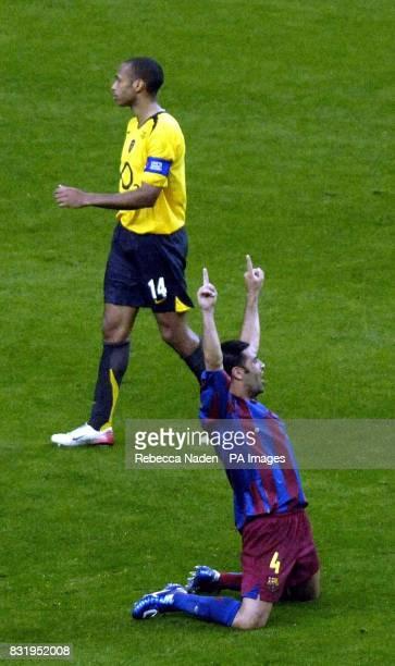 Barcelona's Rafael Marquez celebrates as Arsenal's Thierry Henry walks past him after the UEFA Champions League final at Stade de France Paris France