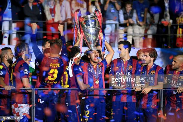 Barcelona's Rafinha celebrates with the trophy as confetti rains down on them