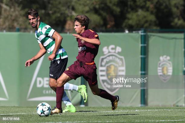 Barcelona's Ricard Puig with Sporting CP Goulart Silva in action during the UEFA Youth League match between Sporting CP and FC Barcelona at CGD...