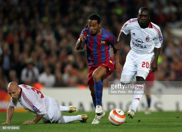 Barcelona's Ronaldinho attempts to escape from AC Milan's Clarence Seedorf and Jamp Stam during the Champions League semifinal second leg match at...