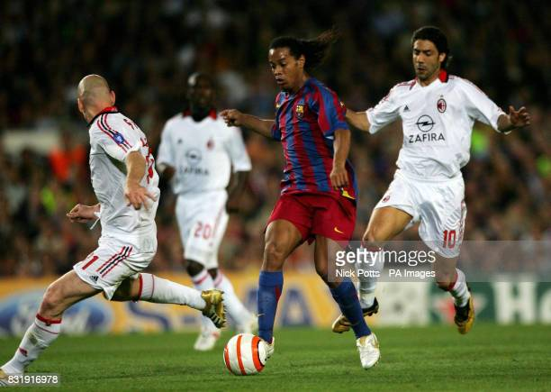 Barcelona's Ronaldinho attempts to escape from AC Milan's Clarence Seedorf and Jaap Stam during the Champions League semifinal second leg match at...