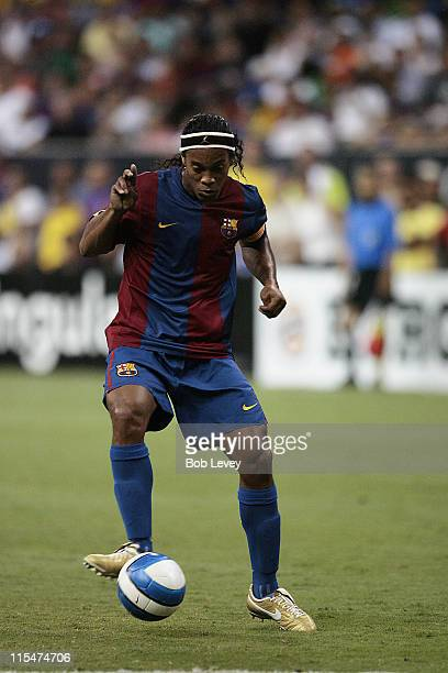 FC Barcelona's Ronaldinho brings the ball up field during friendly play between FC Barcelona and Club America Aug 9 2006 in Houston Texas