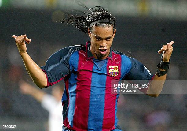 Barcelona's Ronaldinho De Asis Moreira of Brazil celebrates after scoring against SK Matador Puchov's during a UEFA Cup soccer match in Barcelona 15...