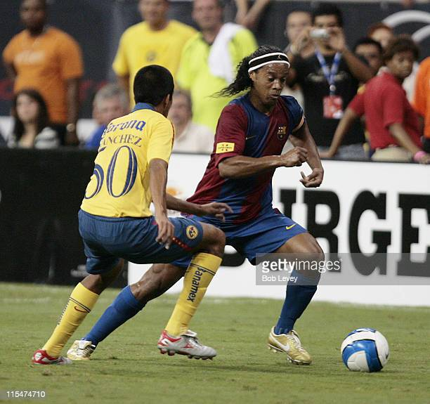 FC Barcelona's Ronaldinho dribbles past a Club America defender during friendly play between FC Barcelona and Club America Aug 9 2006 in Houston Texas