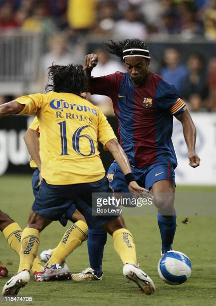 FC Barcelona's Ronaldinho dribbles past Club America's Ricardo Rojas during friendly play between FC Barcelona and Club America Aug 9 2006 in Houston...