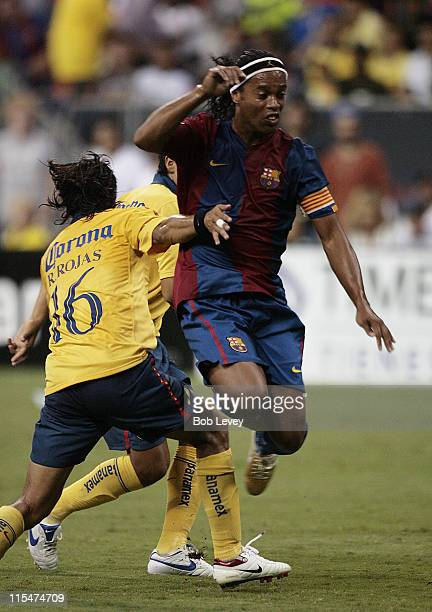 FC Barcelona's Ronaldinho dribbles past Club America's Ricardo Rojas during friendly play between FC Barcelona and Club America Aug 9 2006 in Houston...