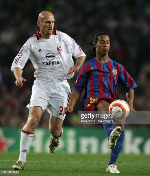 Barcelona's Ronaldinho in action with AC Milan's Jaap Stam during the Champions League semifinal second leg match at The Nou Camp Barcelona Spain