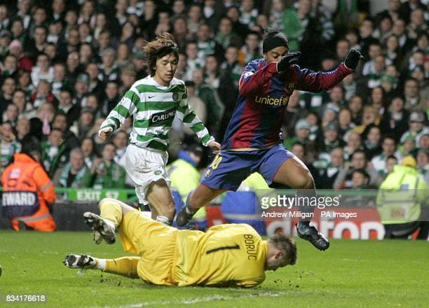 Barcelona's Ronaldinho jumps over Celtic's goalkeeper Artur Boruc as he heads towards the goal
