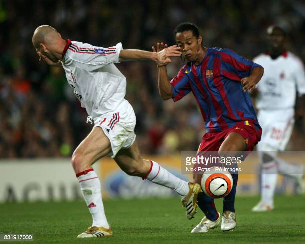 Barcelona's Ronaldinho tussles with AC Milan's Jaap Stam during the Champions League semifinal second leg match at The Nou Camp Barcelona Spain