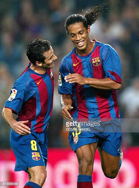 Barcelona's Ronaldinho with Giuly of France celebrates after scoring against Osasuna during their Spanish league football match at theCamp Nou...
