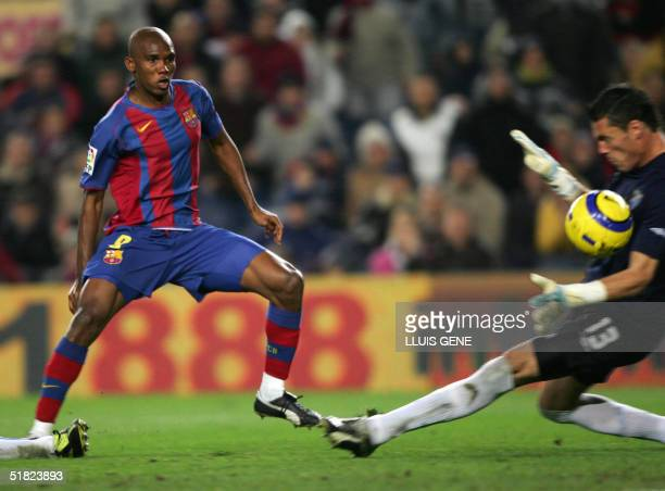 Barcelona's Samuel Eto'a of Cameroon scores over Malaga's goalgeeper Calatayud in a Spanish League football match at the Camp Nou stadium in...