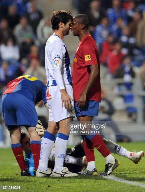FC Barcelona's Samuel Eto´o vies with Recreativo's Huelva Cesar Arzo during their Spanish league football match at the Nuevo Colombino's stadium in...