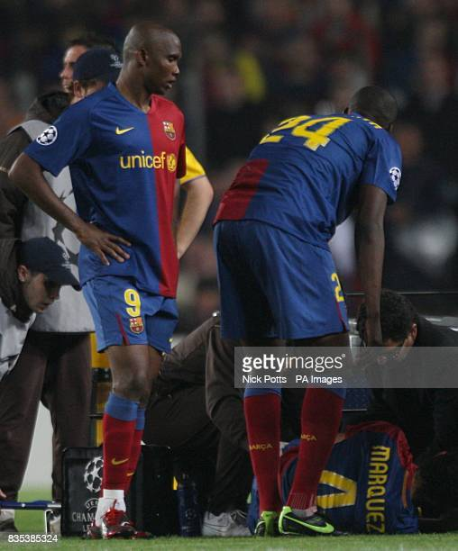 Barcelona's Samuel Eto'o watches over team mate Rafael Marquez who lies injured on the floor