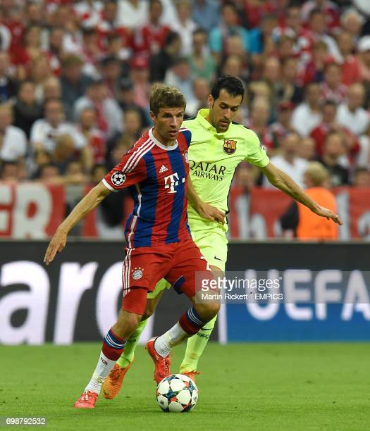 Barcelona's Sergio Busquets and Bayern Munich's Thomas Muller battle for the ball