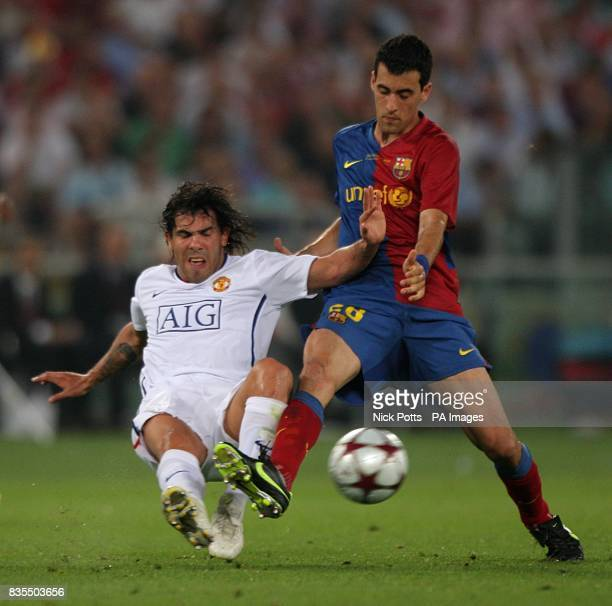 Barcelona's Sergio Busquets and Manchester United's Carlos Tevez battle for the ball