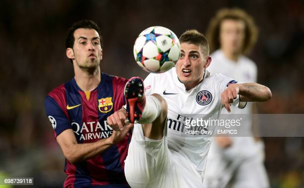 Barcelona's Sergio Busquets and Paris SaintGermain's Marco Verratti battle for the ball in the air