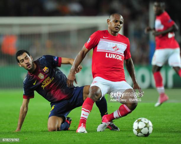 Barcelona's Sergio Busquets and Spartak Moscow's Ari battle for the ball