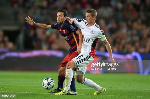 Barcelona's Sergio Busquets battles with and Bayer Leverkusen's Lars Bender