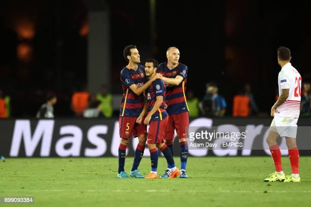 Barcelona's Sergio Busquets celebrates with Pedro and Jeremy Mathieu