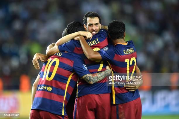 Barcelona's Sergio Busquets celebrates with teammates